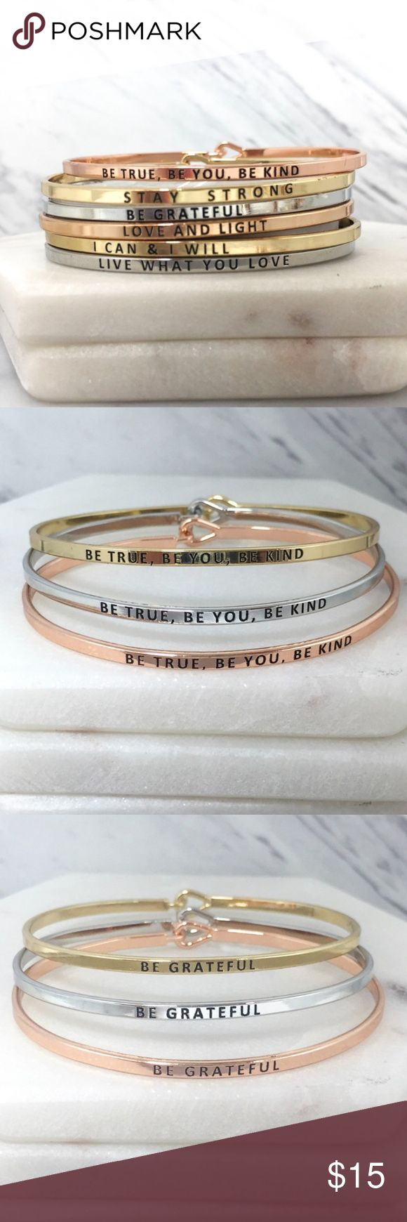 """Inspirational Mantra Motivational Saying Bracelet Skinny mantra bangle bracelet. Buy multiple and stack them all! Hook closure. Stackable inspirational bracelets.  60 mm X 45 mm Diameter: 2.75 inches  """"STAY STRONG"""" """"LOVE AND LIGHT"""" """"LIVE WHAT YOU LOVE"""" """"BE TRUE, BE YOU, BE KIND"""" """"BE GRATEFUL"""" """"I CAN & I WILL All words are available in silver, gold, and rose gold. Please indicate in the comment section, the saying you want and it what color. Don't forget to make an offer. You can also place…"""