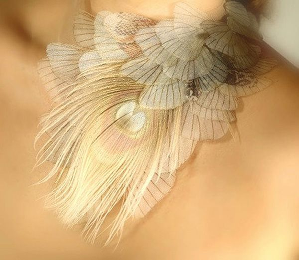 Necklace   Derya Aksoy.  She projects real photos of butterflies, moths and dragonflies onto crystal organza before delicately snipping and weaving with feathers, jewels and beads to make her pieces.