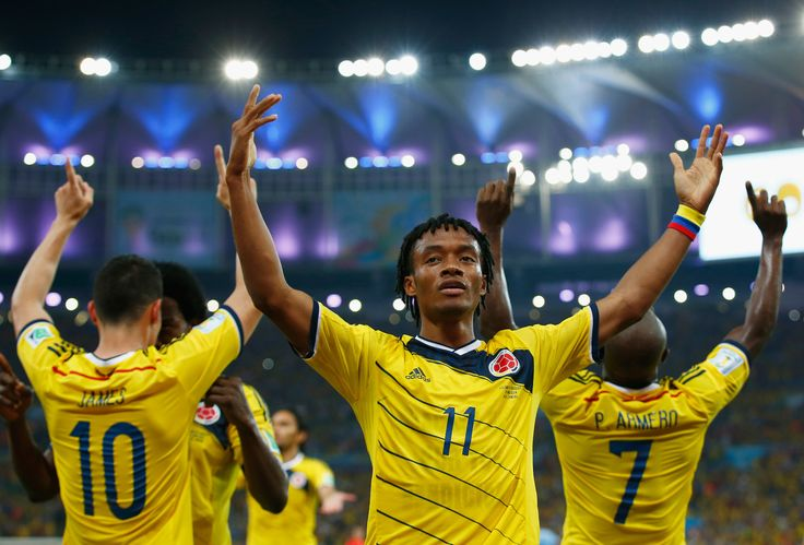 Juan Guillermo Cuadrado of Colombia celebrates his team's second goal scored by James Rodriguez (L) during the 2014 FIFA World Cup Brazil round of 16 match between Colombia and Uruguay at Maracana on June 28, 2014 in Rio de Janeiro, Brazil. (Photo by Clive Rose/Getty Images)