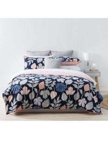 The Lanie duvet cover set blends bold autumn leaves and printed chambray flowers for an organic look, and a warm, textural feel for  winter.