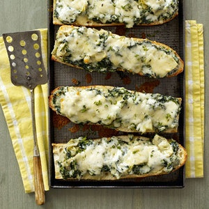 Spinach-Artichoke French Bread, 30-Minute Meals   http://www.rachaelraymag.com/Recipes/rachael-ray-magazine-recipe-search/rachael-ray-30-minute-meals/spinach-artichoke-french-bread-pizza