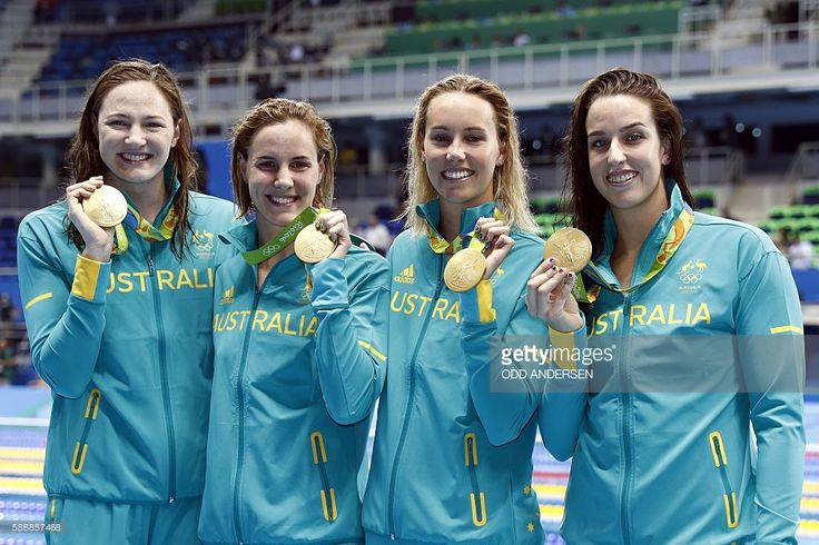 Team Australia, Australia's Emma Mckeon, Australia's Brittany Elmslie, Australia's Bronte Campbell and Australia's Cate Campbell pose with their gold medals on the podium after they broke the world in the Women's 4 x 100m Freestyle Relay Final during the swimming event at the Rio 2016 Olympic Games at the Olympic Aquatics Stadium in Rio de Janeiro on August 6, 2016. / AFP / Odd ANDERSEN