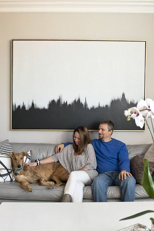 Single oversized piece of art above sofa