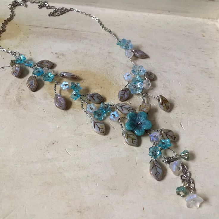 Excited to share the latest addition to my #etsy shop: Turquoise Grey Flower Vine Charm Necklace; blues white Flower mix, silver wire wrapped, silver chain, bell flowers, floral necklace