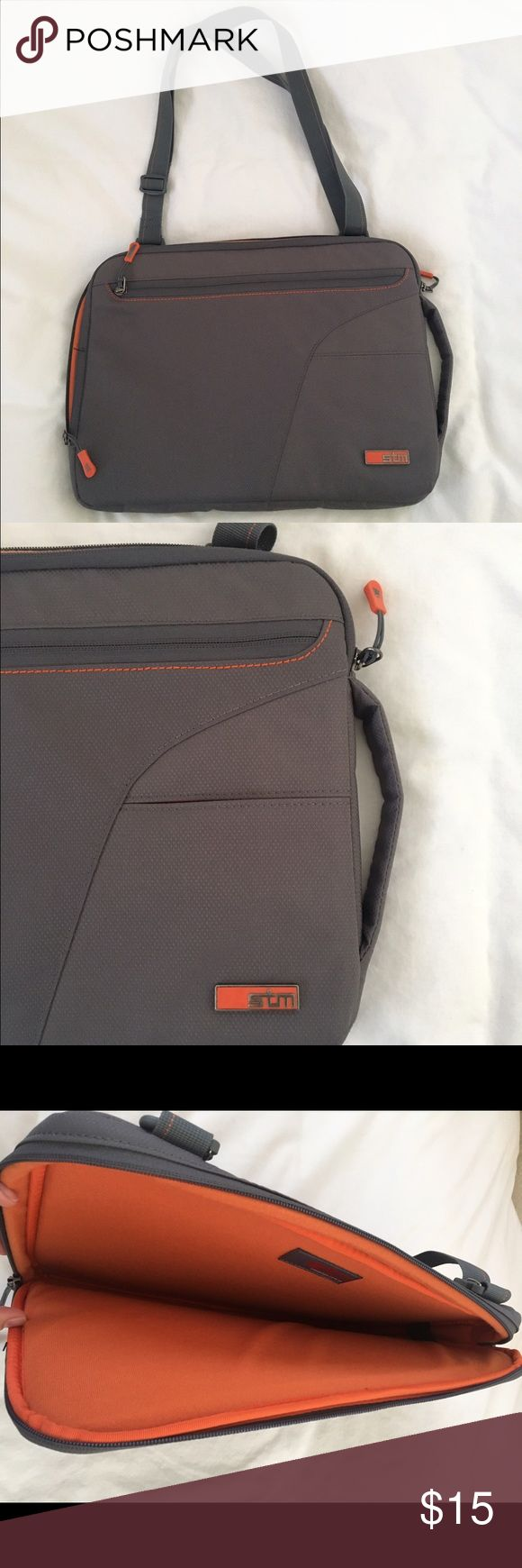 STM laptop bag STM Laptop Bag/Case. Has shoulder strap and carrying handle. Sides of Bag are VERY padded. Orange felt inside and gray on outside. Has one zipper pocket on outside and two other pockets. GREAT condition! Bags Laptop Bags