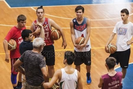 Basketball team meating in the playing field – Stock Editorial Photo © carlotoffolo #148623181