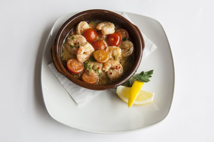 Shrimp Pil Pil: Sautéed Shrimp, E.V. Olive Oil, Garlic, Baby Tomatoes, Parsley & Red Chillies topped with White Wine & freshly-squeezed Lemon juice