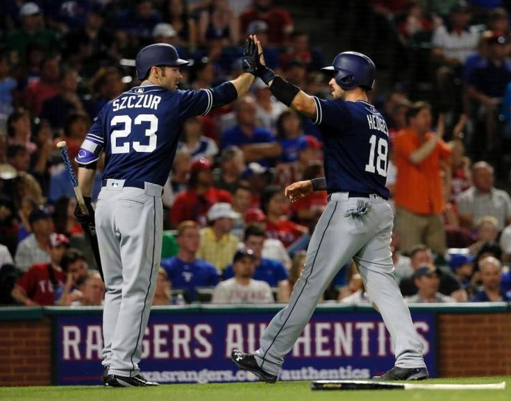 Party at Napoli's: 2nd HR ends Rangers' 5-2 win over Padres  -  May 11, 2017:     San Diego Padres' Matt Szczur (23) and Austin Hedges, right, celebrate after Hedges scored on a sacrifice fly by Manuel Margot during the seventh inning of the team's baseball game against the Texas Rangers on Thursday, May 11, 2017, in Arlington, Texas. (AP Photo/Tony Gutierrez)