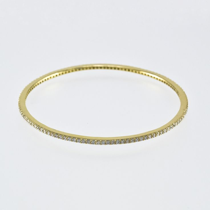 All around CZ gold bangle. Item #: b500-gd