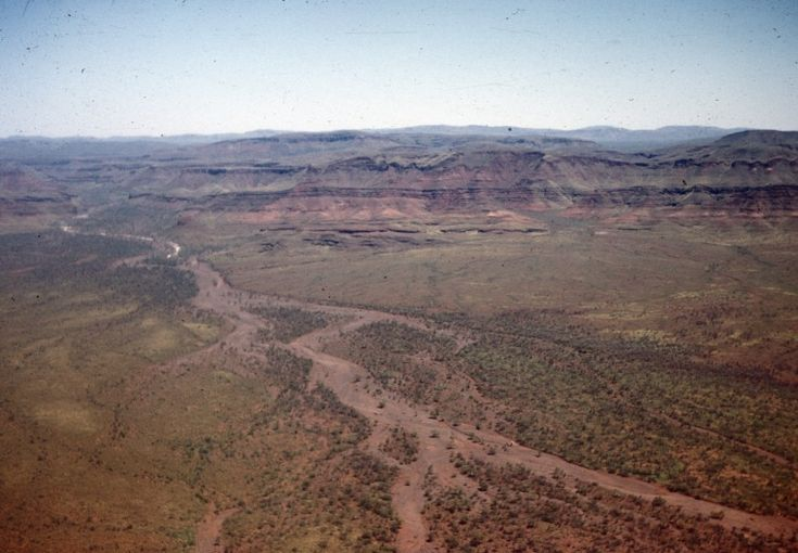 BA2521/293: Following a cyclone, asbestos from slag heaps has flowed from Wittenoom Gorge about 50km across the plain, July 1961 http://encore.slwa.wa.gov.au/iii/encore/record/C__Rb4232405?lang=eng