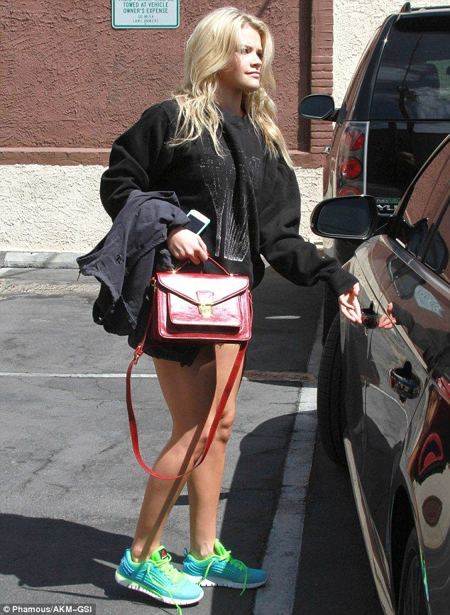 Comfy: Dance pro Witney Carson, who is paired with Fresh Prince Of Bel Air star Alfonso Ribeiro, displayed her shapely stems in tiny shorts with a giant black sweater
