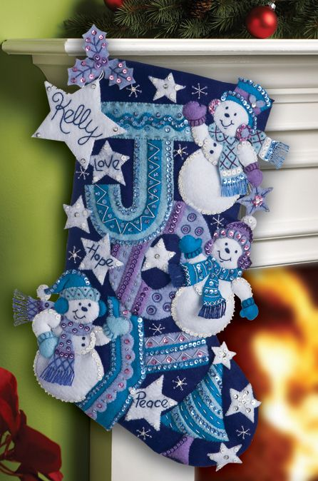 """Joy Snowmen"", felt stocking kit, just released in July 2012. Available at MerryStockings.com, 20.99."