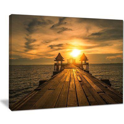 DesignArt Huge Wooden Bridge to Illuminated Sky Photographic Print on Wrapped Canvas Size:
