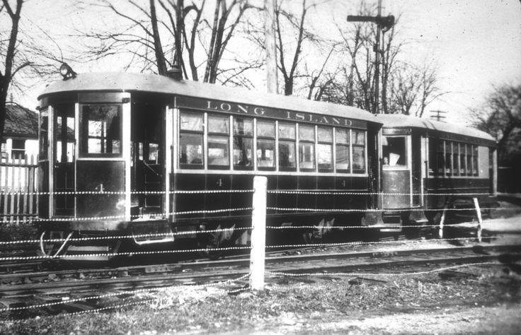"""1910's -- Mineola -- Two of the LIRR's four """"Battery Cars"""" powered by electric batteries that ran on regular train tracks before the LIRR began using the electric third rail in the 1920's. These two cars, No.'s 2 and 4 ran the 7.3 mile line between Valley Stream and Mineola."""