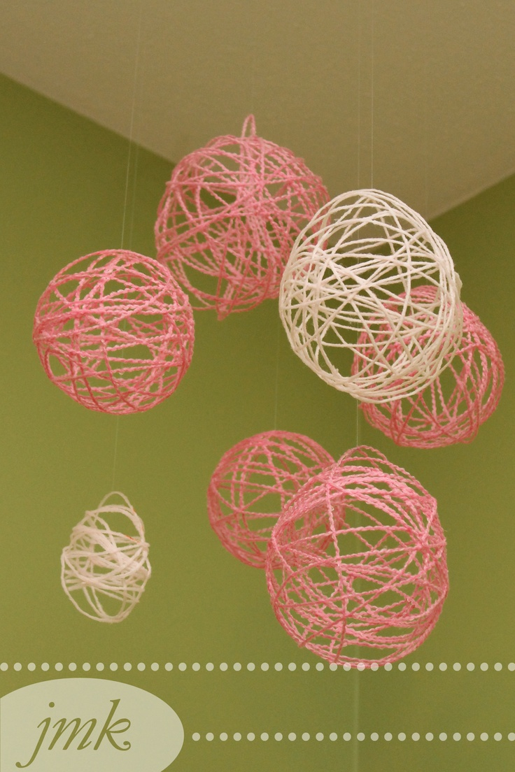 Yarn Ball Mobile.    Pinspiration: http://familyfun.go.com/crafts/yarn-eggs-670275/    Yarn, balloons, 2/3 mod podge 1/3 water. Make sure to use plenty of yarn.