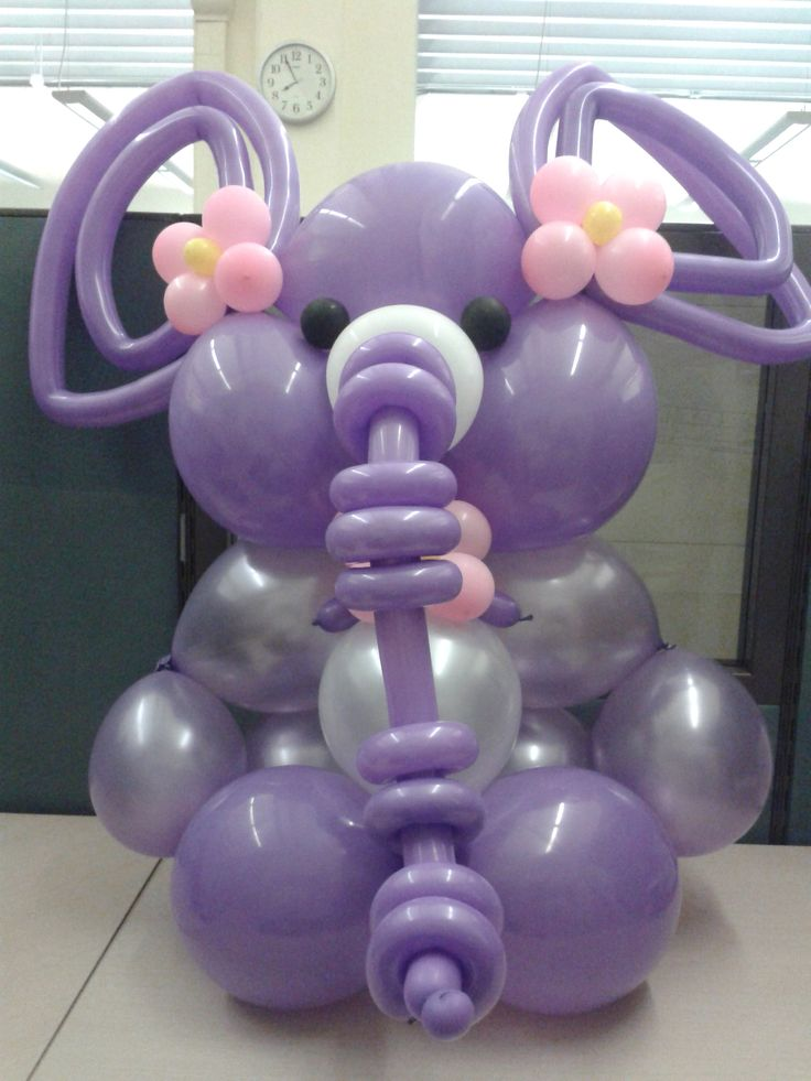 Cute purple elephant balloon sculpture for a baby shower.