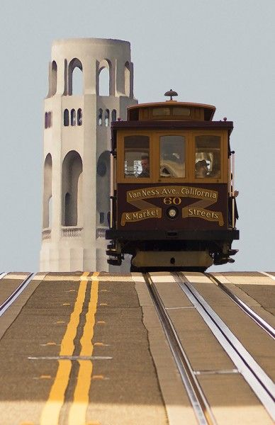 Amazing view of Coit Tower and a Cable Car going downhill, San Francisco