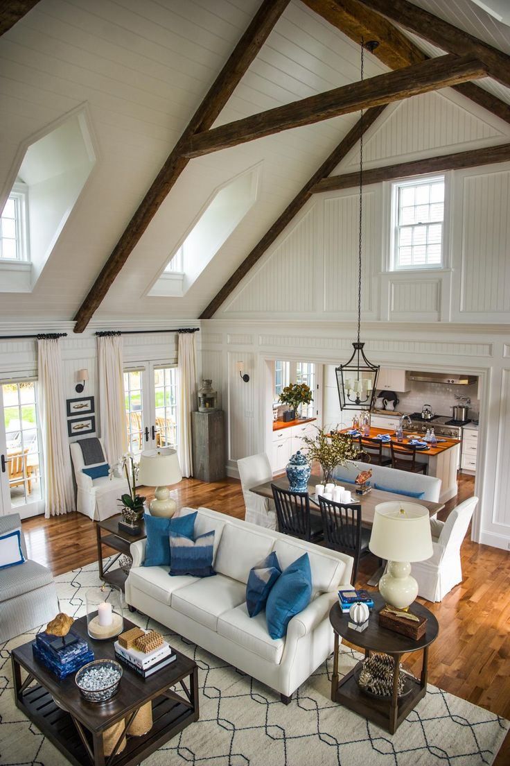white paneled ceiling, stained beams. Open dining & living room.