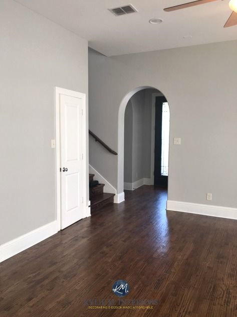 Sherwin Williams Repose Gray, a warm gray paint colour with laminate wood flooring in entryway, stairwell and great room. Kylie M Interiors E-design and Online Colour Consulting services