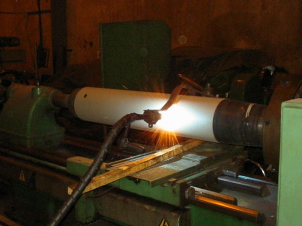 This is an image of thermal spray wire in process. Thermal spraying is a process where it uses wire as feed stock.