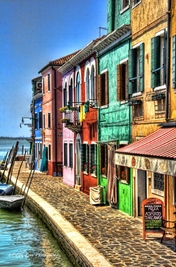 Burano, Veneto, Province of Venezia , Italy Burano is a fishermen's village and a photographer's dream with its brightly colored houses