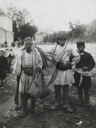 NAVPLION, PELOPONNESUS PENINSULA, GREECE. An informal group portrait of three Peloponnesian men. Simpich, Frederick Sr., Atelier L. And.   Credit: National Geographic Stock: Vintage Collection / The Granger Collection, NYC — All rights reserved.  1922      Image No. 0253516      Credit: National Geographic Stock: Vintage Collection / The Granger Collection, NYC — All rights reserved.
