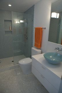 Love the way the glass bowl sink coordinates with the shower tile color - both look really good with white