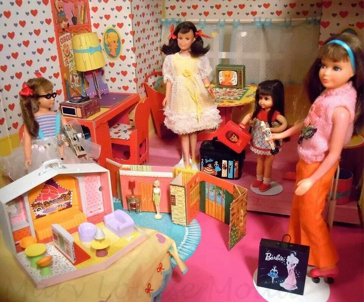 Tutti, Skooter, Chris and Skipper in Skipper's 1964 Dream Room - The miniature Barbie doll cases are Hallmark ornaments. The miniature Dream House originally came with Skipper's Dream Room.
