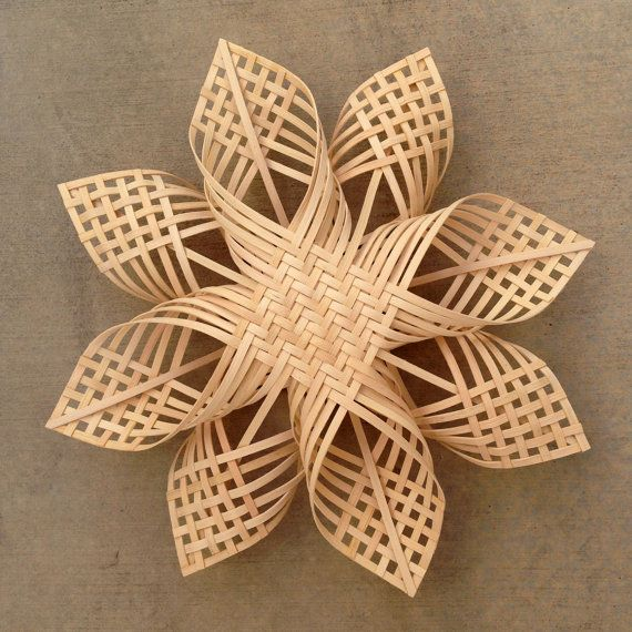 HISTORY: This woodland star design is the marriage of the century-old German star (later the Swedish advent star) with the Native American tradition of plait weaving, which has been around for millennia.  DETAILS: This made to order star has a special closed weave center called the 2/2 twill, a standard plait weaving pattern. Constructed from quarter inch flat rattan, this star can be hung anywhere indoors. It also makes a great tree topper. © 2011  MEASUREMENTS: Approximately 16 (41cm) in…