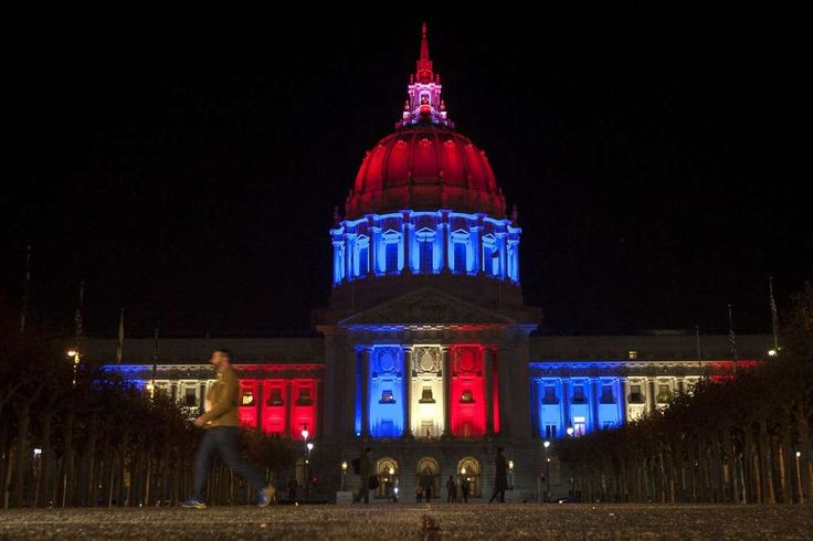 City Hall changed its lights top project the flag of France , Friday, Nov. 13, 2015, in San Francisco, Calif. Paris was rocked by a string of deadly attacks that left more than 100 dead. Photo: Santiago Mejia, Special To The Chronicle