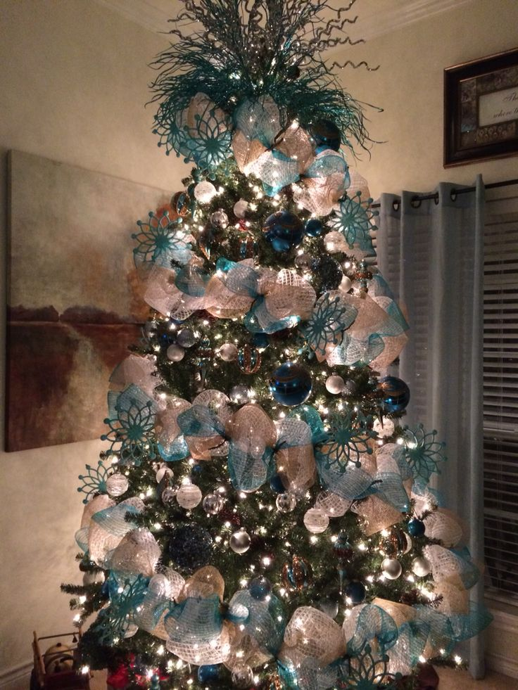 Our Christmas Tree. Teal, white and silver. I'm in love with it.