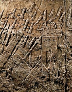 Old Testament Artifacts ~ Assyrians attack the Jewish fortified town of Lachish. Part of a relief from the palace of Sennacherib at Nineveh.