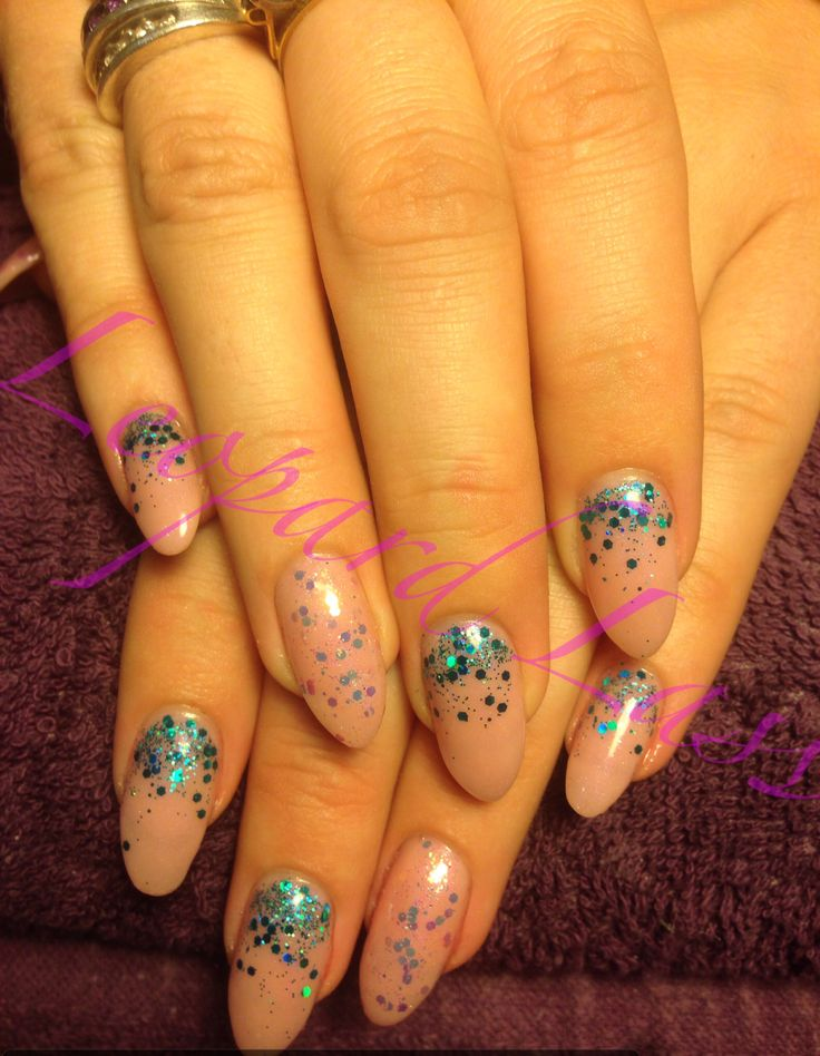 Acrylic nails with teal glitter fade and iridescent glitter feature nail