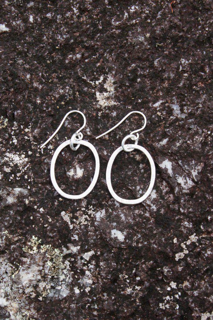 Sterling silver coated oval earrings