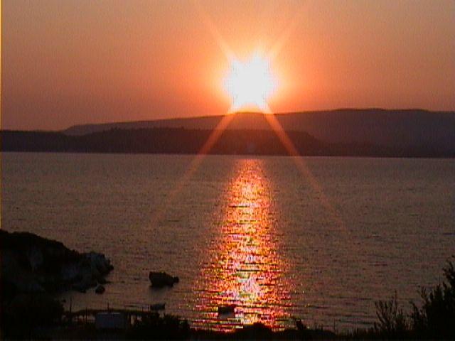 The sun sets over lixouri peninsula