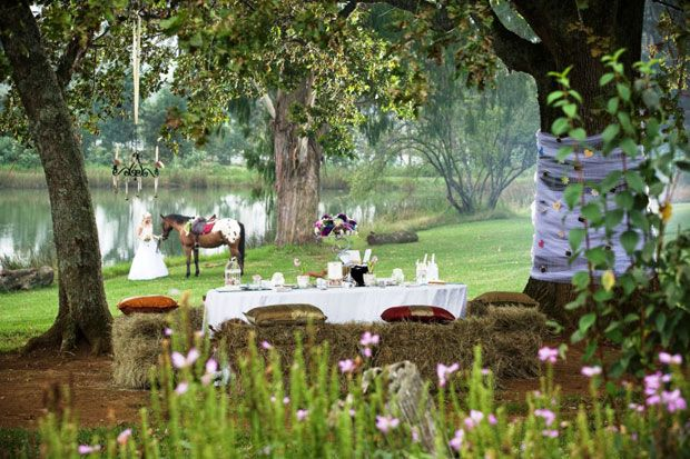 An intimate country wedding: horses, hay bales, flowers, dam. Cranford Country Lodge, Midlands Meander, KZN, South Africa. Explore the area: www.midlandsmeander.co.za