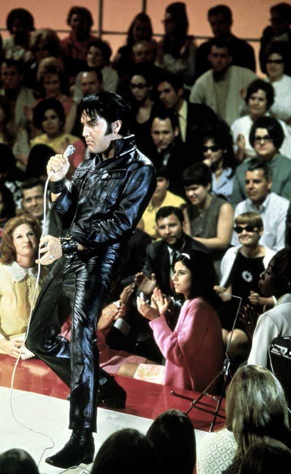 Elvis 68 Comeback Special Live. I have yet to see a man who wears leather like elvis. Fucking hot.