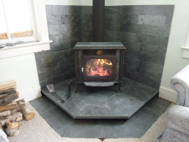 Idea for floating wood stove hearth. Don't need extra tile on floor