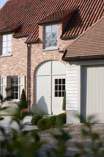 Design harmony of the neutral timber cladding and reclaim brick, rosemary pan tile and clay tile roof