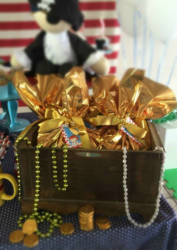 Golden treasure favors at a pirate birthday party! See more party planning ideas at CatchMyParty.com!
