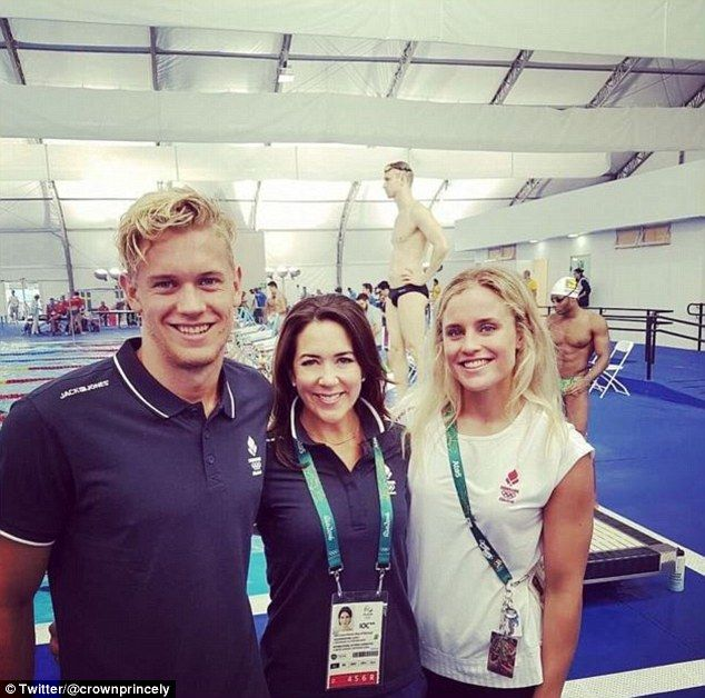 Gold and silver: The Princess (pictured with Danish swimming team members) said: 'It would...