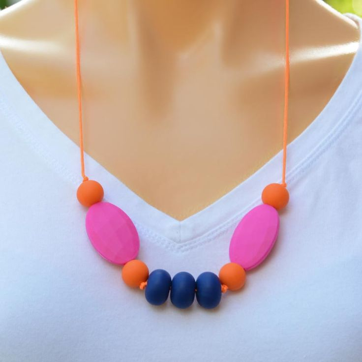 Summer Nights teething necklace for mums to wear and bubs to chew on. Hot summer colours.
