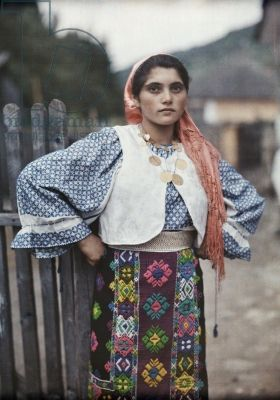 A gypsy girl poses in traditional clothing and jewelry, Rucar, Romania,  1934 (autochrome) ***