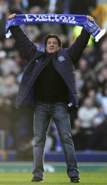 Hollywood Actor Sylvester Stallone salutes the fans with an Everton scarf prior…