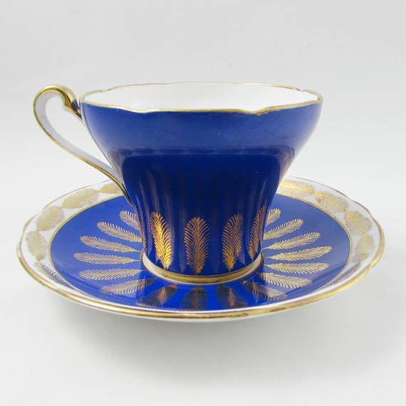 Made by Royal Stafford, tea cup and saucer have a pretty blue color and gold trimming. In the inside of the tea cup there are bouquets of flowers. Great condition with no chips of cracks, please note there is minor wear to the gold on the handle of the tea cup (see photos). Markings