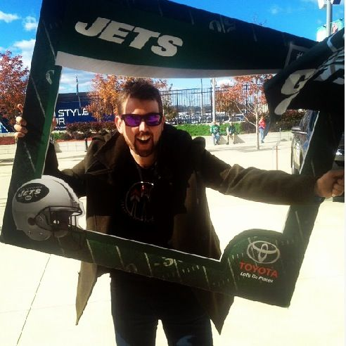 This was a cool idea at the NY Jets NFL game. Hold a big pic cut out and a Jets/Sponsor (toyota in this case) would take your pic.