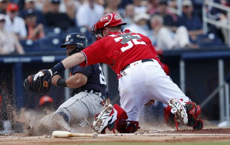 2018 MLB spring training - OUT AT HOME:   Washington Nationals catcher Matt Wieters (32) tags out Miguel Cabrera of the Detroit Tigers during a spring training game in West Palm Beach, Fla., on March 4.