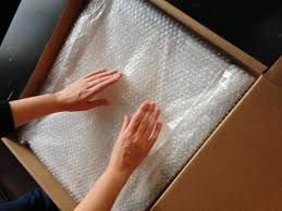 If you don't have enough, bubble wrap is a great solution, but newspaper is just as effective, usually less expensive, and can be recycled once you're in your new home.