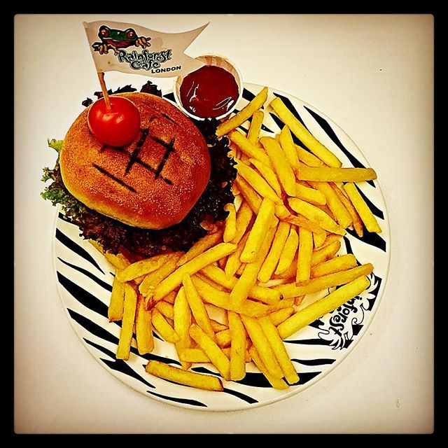Our new menu still has some of our most popular dishes such as the Rainforest Classic Steak Burger. 100% beef burger piled high with full-flavoured relish, Cheddar cheese, lettuce, tomato & onion rings, served in a toasted brioche bun with a side of fries. #burger #cheeseburger #london #food #restaurant #fries #flag #treefrog #zebra #instafood #instagood