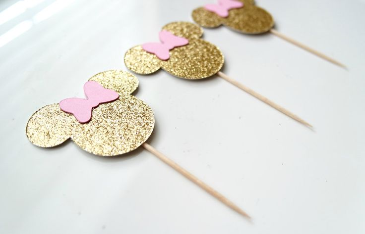 Minnie Mouse Cupcake Toppers - Minnie Mouse Party Decor - Gold Minnie Head and Pink Bow. by ExclusiveAllure on Etsy https://www.etsy.com/listing/464761946/minnie-mouse-cupcake-toppers-minnie